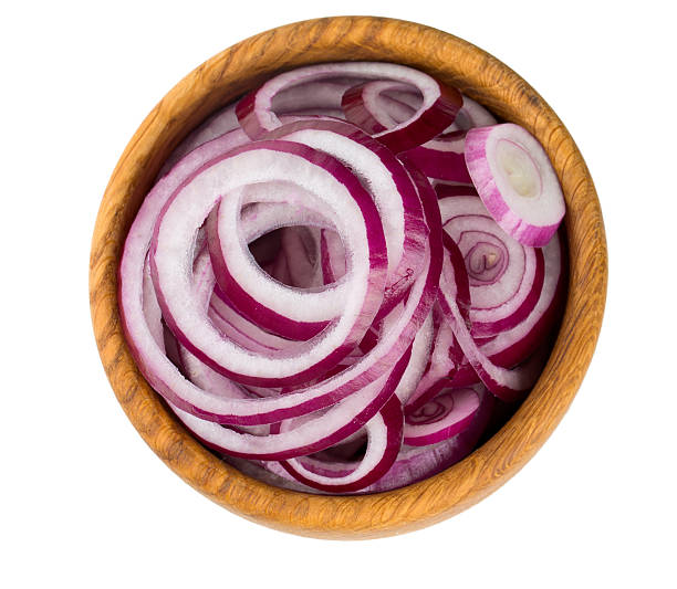 red onion slices in a wooden bowl isolated on white red onion slices in a wooden bowl isolated on white spanish onion stock pictures, royalty-free photos & images
