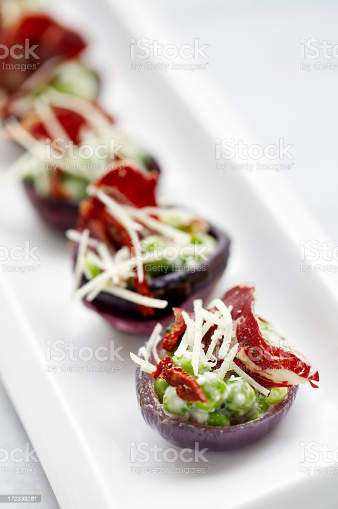 Red onion with cheese,peas and pastrami royalty-free stock photo