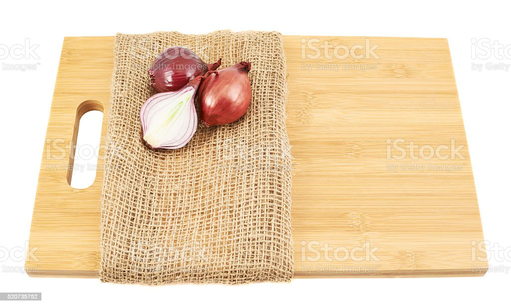 Red onions composition over cutting board stock photo