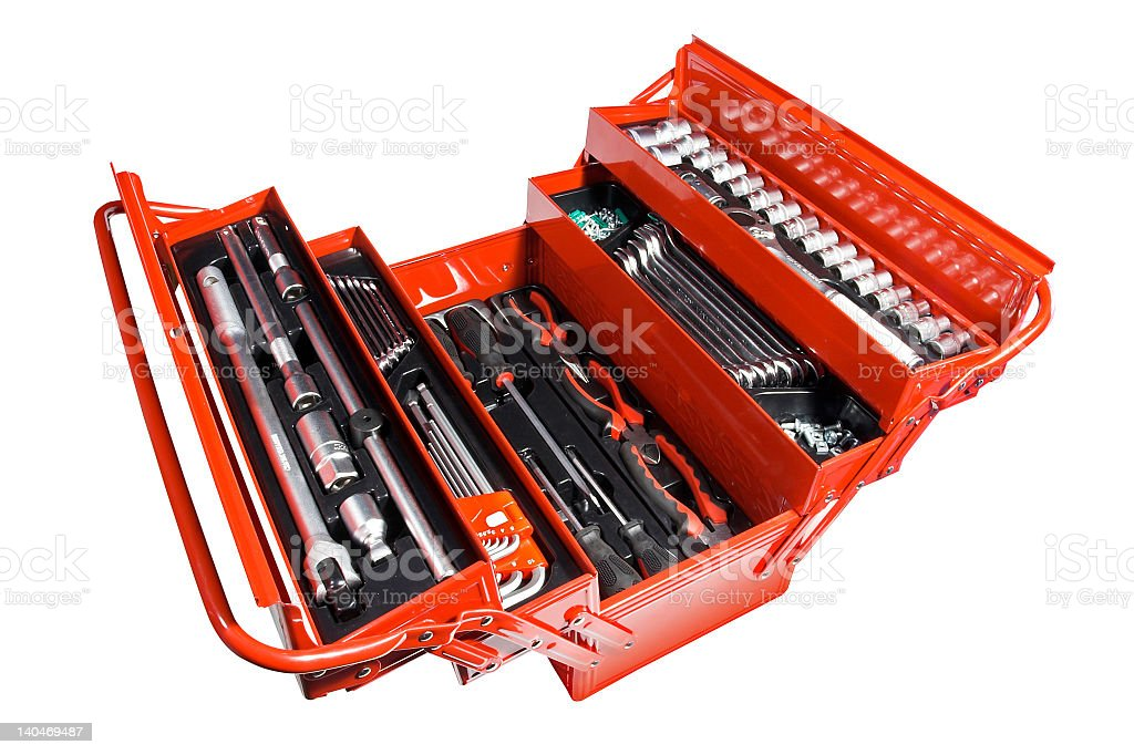 Red open toolbox full of tools arranged tidily stock photo