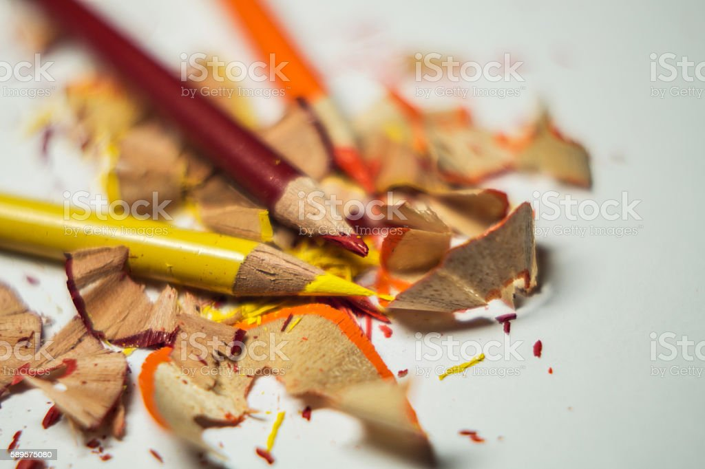 red, orange and yellow color pencil sharpened with shavings royalty-free stock photo