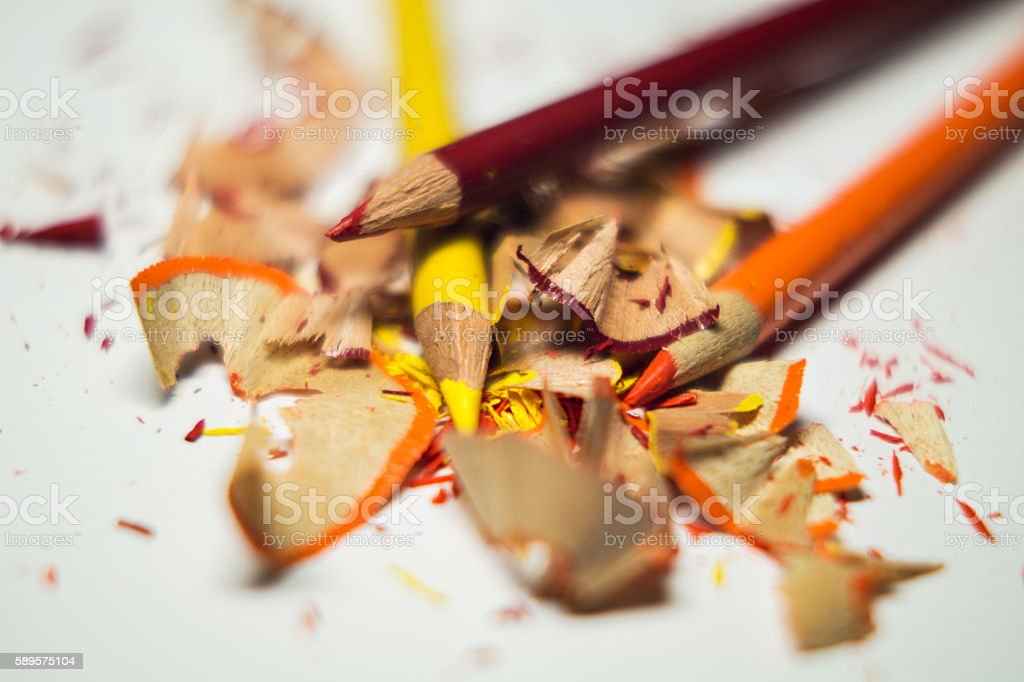 red, orange and yellow color pencils sharpened with shavings stock photo