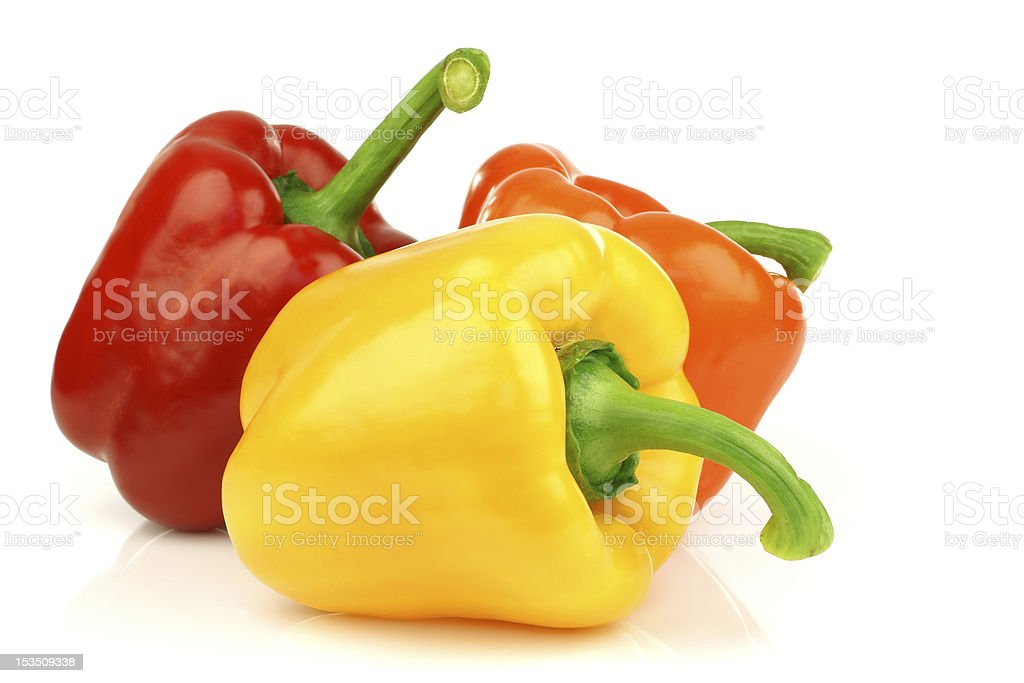 Red, orange and yellow paprika on a white background stock photo