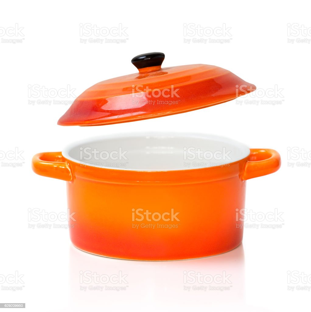Red orange ceramic pot pan opened cover isolated. stock photo
