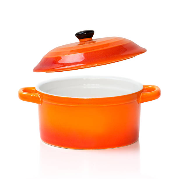 red orange ceramic pot pan opened cover isolated. - kookgerei stockfoto's en -beelden