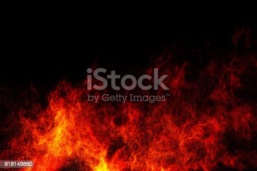 918139336istockphoto Red orange color powder explosion cloud isolated on black background. 918149880