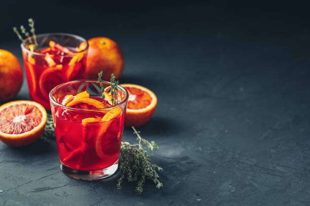 Red orange juice in a large glass or aperitif with campari stock photo