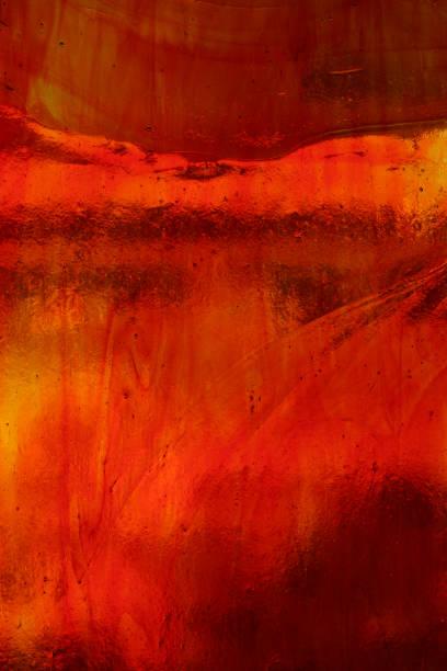 red orange buntglas - glasmalerei stock-fotos und bilder