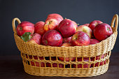 red organic apples in a beautiful basket