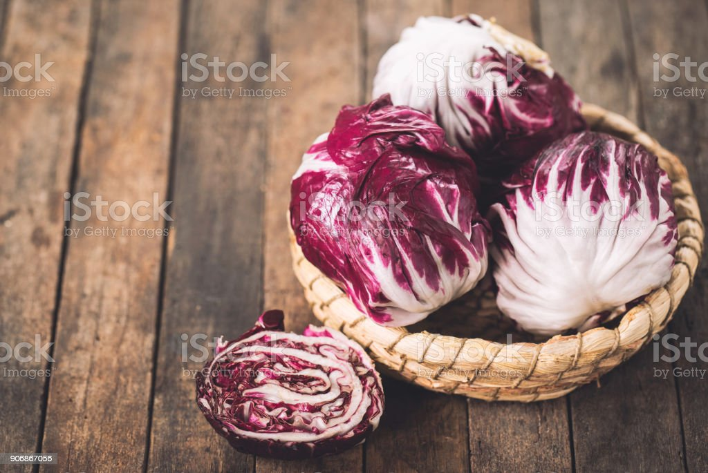 Red organic radicchio in the basket stock photo