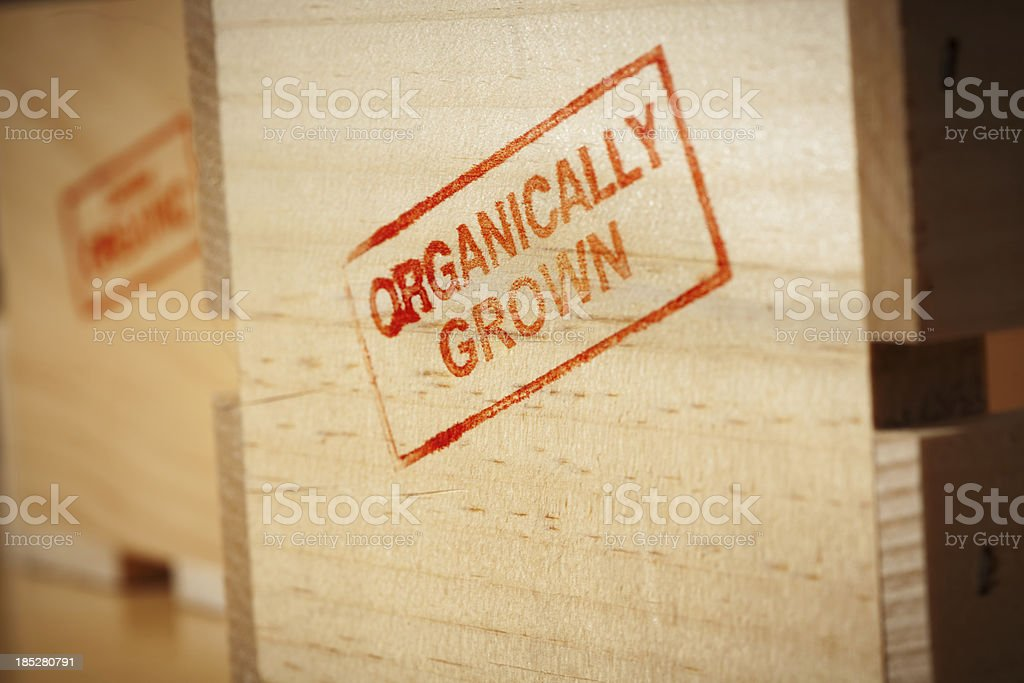 Red Organically Grown Rubber Stamp Impression on Produce Wooden Crate royalty-free stock photo