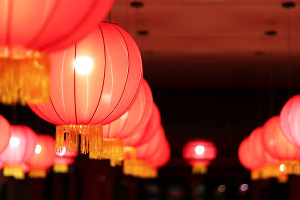 red oriental lanterns in blur - lunar new year stock pictures, royalty-free photos & images