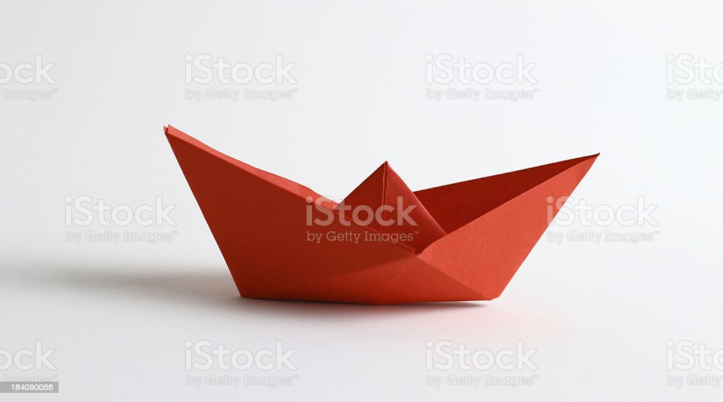 Red origami boat stock photo