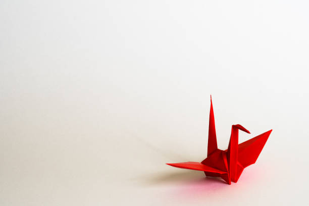 red origami crane - crane bird stock pictures, royalty-free photos & images
