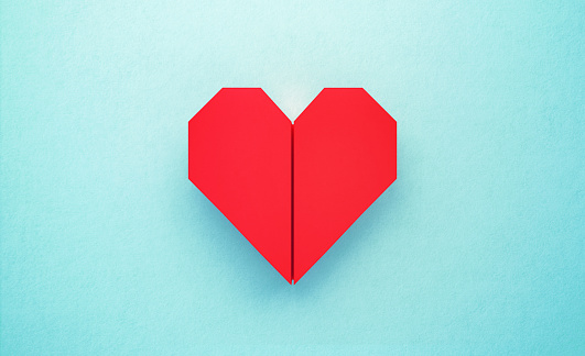 Red Origami Heart on Turquoise Background