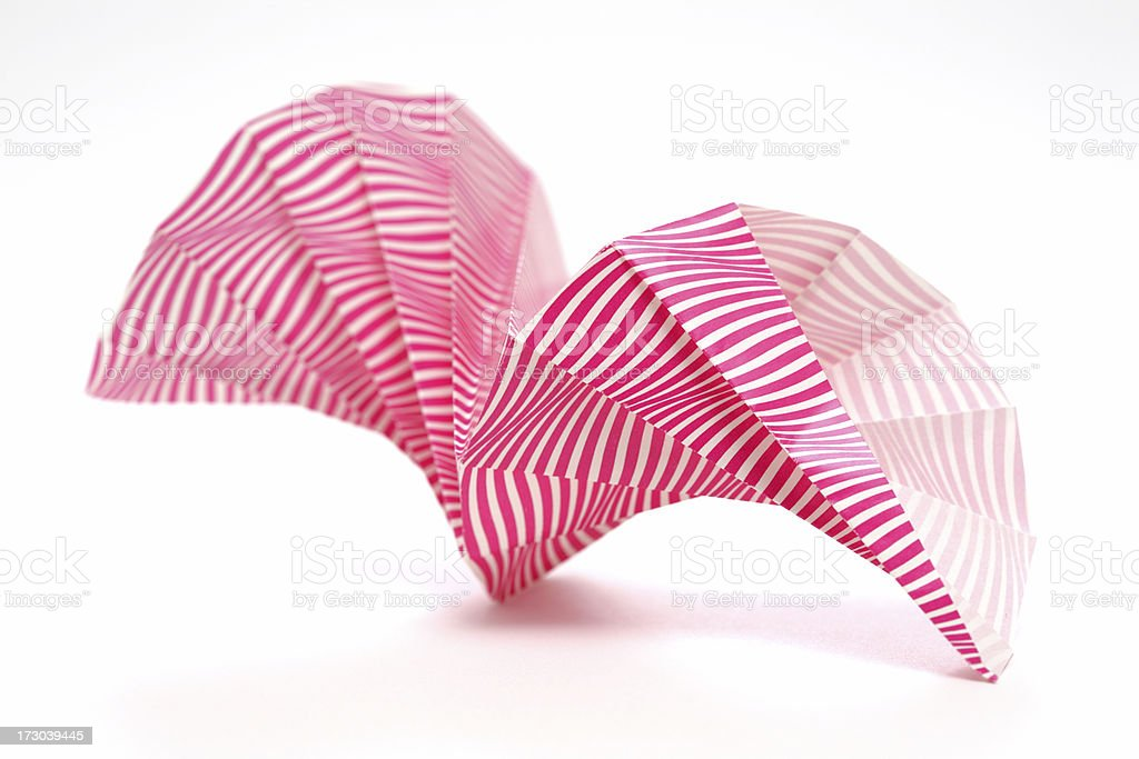 Red origami spiral candy wrapper paper craft design royalty-free stock photo