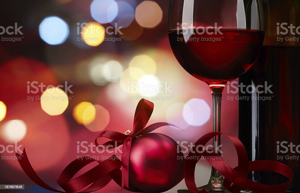 Red ornament and a glass of red wine stock photo