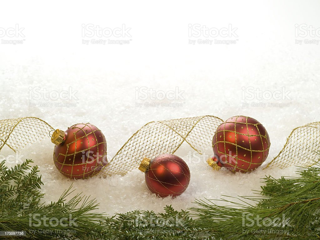 Red ornaments with evergreens stock photo