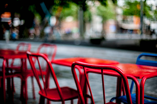 red outdoor chairs stock photo
