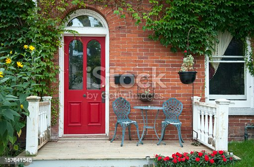 A front porch with a red door