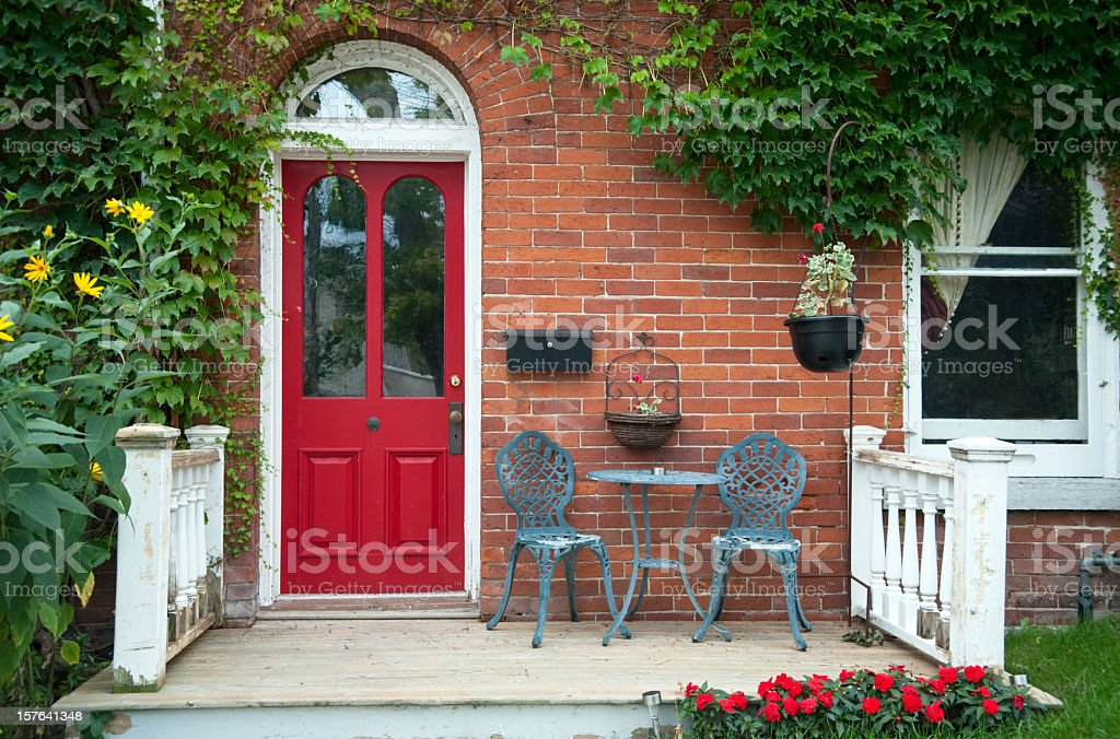 Red outside door with a patio and seating stock photo