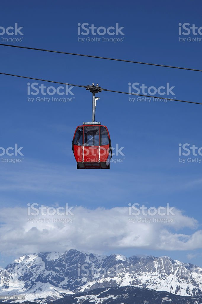red overhead cable car against a blue sky royalty-free stock photo