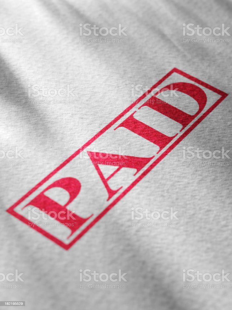 Red Paid Stamped on Textured Paper royalty-free stock photo