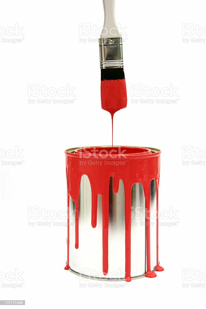 Red paint dripping from the brush to the tin royalty-free stock photo