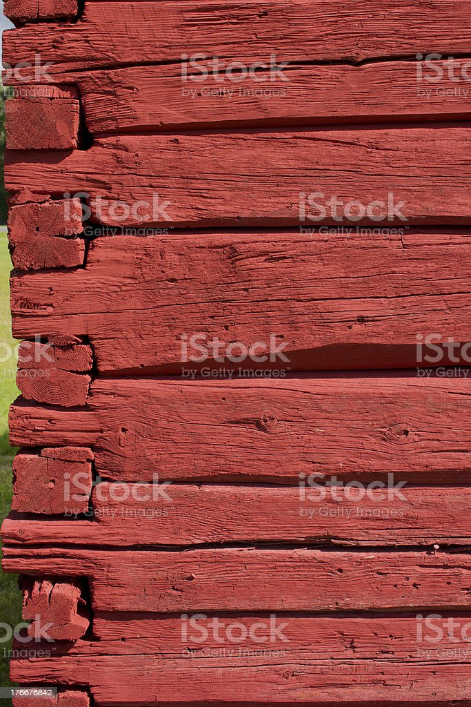Red painted, hand carved old log wall, texture material. royalty-free stock photo