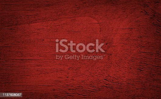 Close up on wooden surface, with red color conversion made with Photoshop.