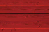 Close-up view of a painted red wooden panel.