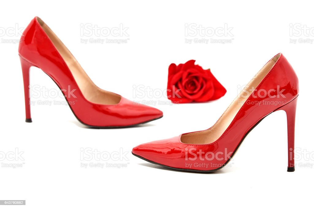 A red pair of women's heel shoes with red rose stock photo