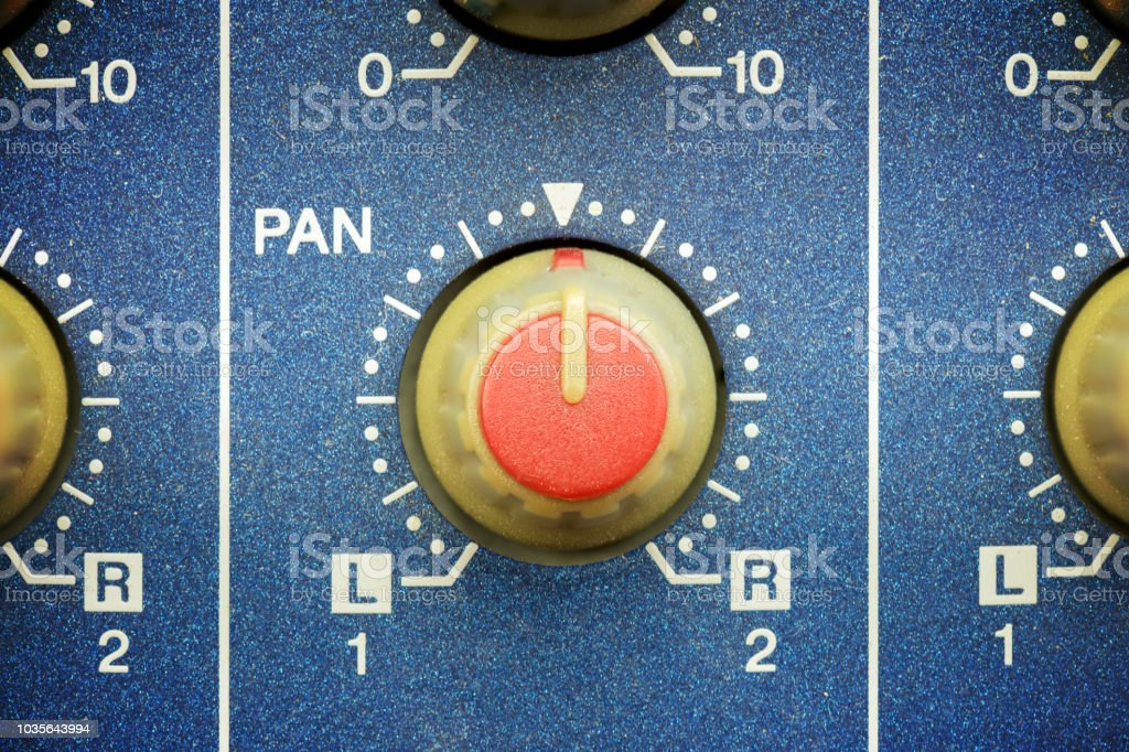 red pan knob on a blue mixing tabl stock photo