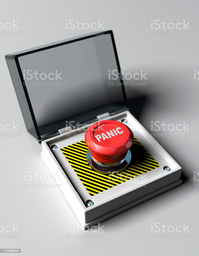 A red panic button is a small black and white box stock photo