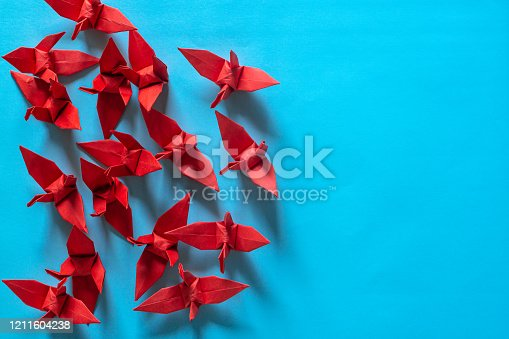 Traditional Japanese origami crane made of red and white paper