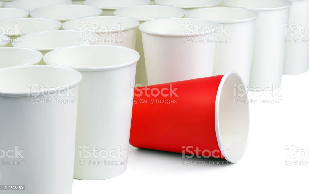 Red paper cup among white caps. - Photo
