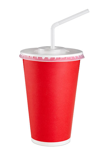 Red paper cup isolated on white background. Red paper cup isolated on white background. Close up. disposable cup stock pictures, royalty-free photos & images