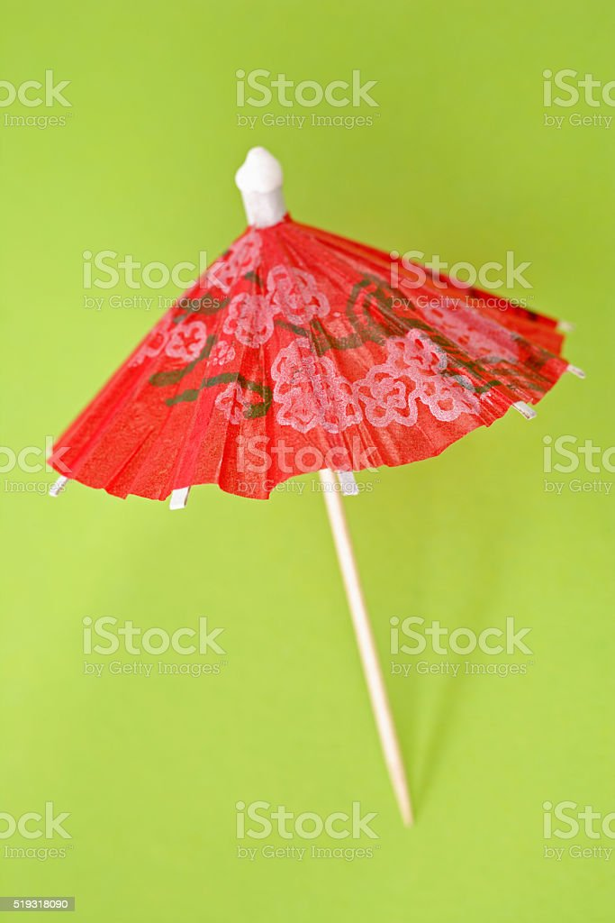 Red paper drink umbrella stock photo