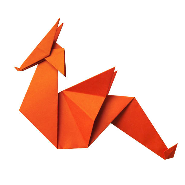 Red paper folded geometrical polygonal origami dragon on white background isolated. stock photo