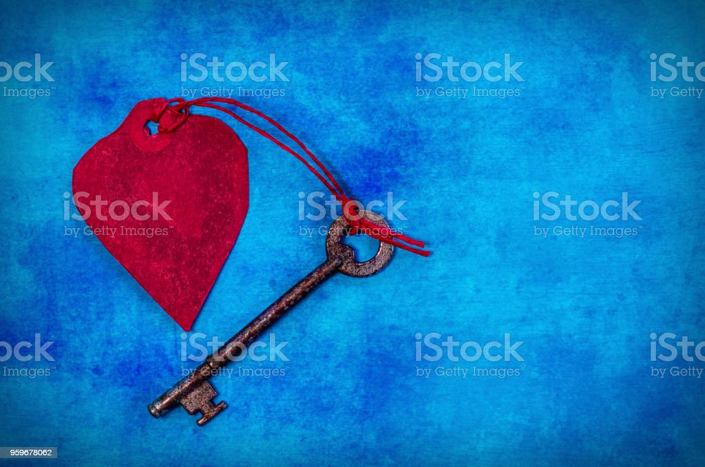 Red Paper Heart and an old key with copy space stock photo
