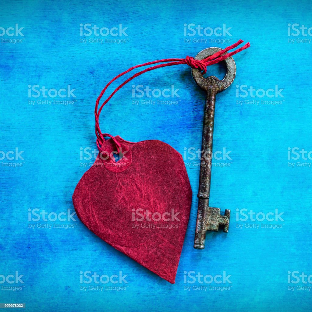 Red Paper Heart Tied To a Key stock photo