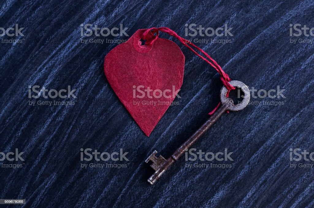 Red Paper Heart with a black grunge effect background stock photo