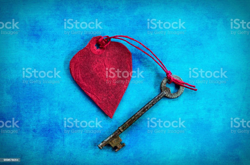 Red Paper Heart with a Key tied below stock photo