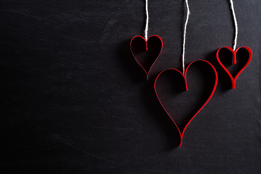 Red Paper Hearts Hanging On Ropes On Black Background Love And Valentines Day Concept Stock Photo - Download Image Now