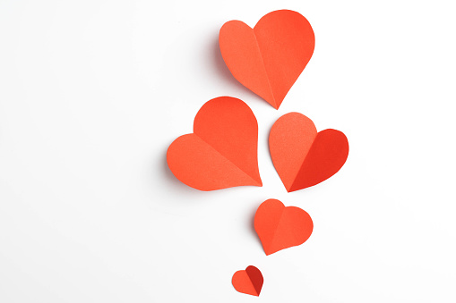 Red paper hearts isolated on white background