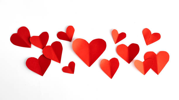 red paper hearts isolated on white - heart shape stock photos and pictures