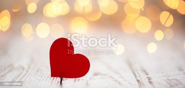 istock Red paper hearts on light bokeh background. Valentine's day background. 1094158660