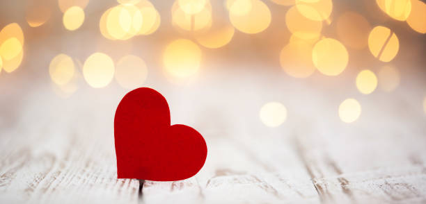 Red paper hearts on light bokeh background. Valentine's day background. Valentine's day background. Red paper hearts on light bokeh background. love stock pictures, royalty-free photos & images