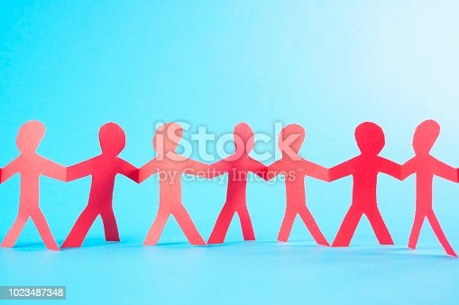 istock Red paper people 1023487348