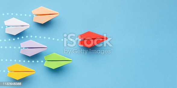 istock Red paper plane leading another ones, leadership concept 1132648388
